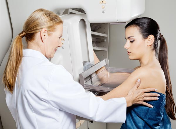 Female Doctor is preparing a woman to mammography examination.