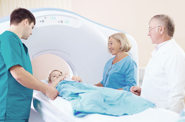 Elder woman, a Doctor and young male nurse standing by the girl before Computed Tomography examination.