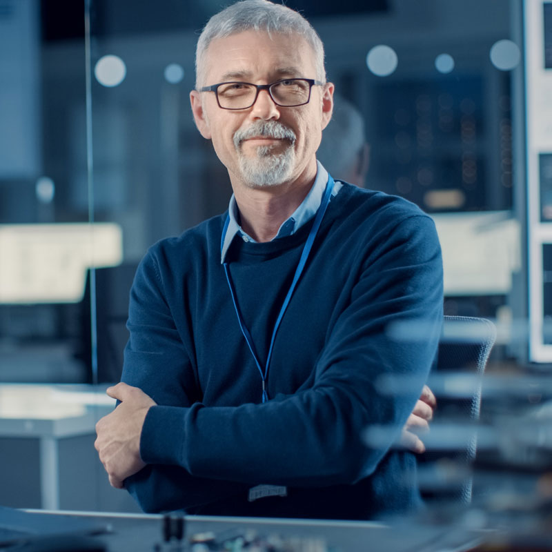 Imaging device manufacturer a well dressed man in glasses.