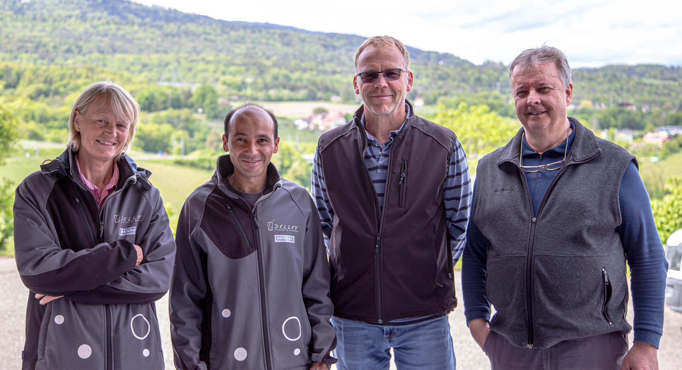 Une photo des quatre collaborateurs de Delley Boissons Sàrl