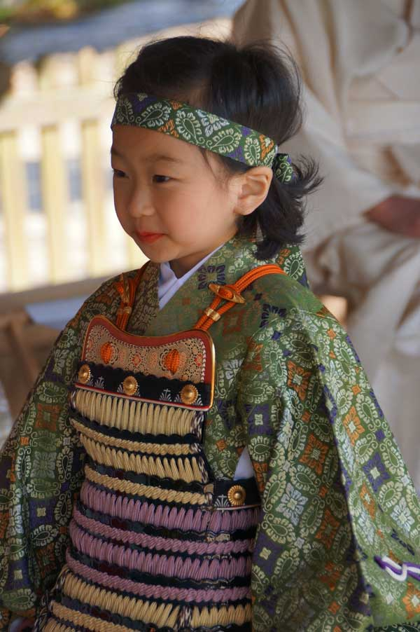 Child smiling in heian armour