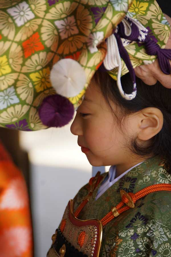 Child taking part in ceremony