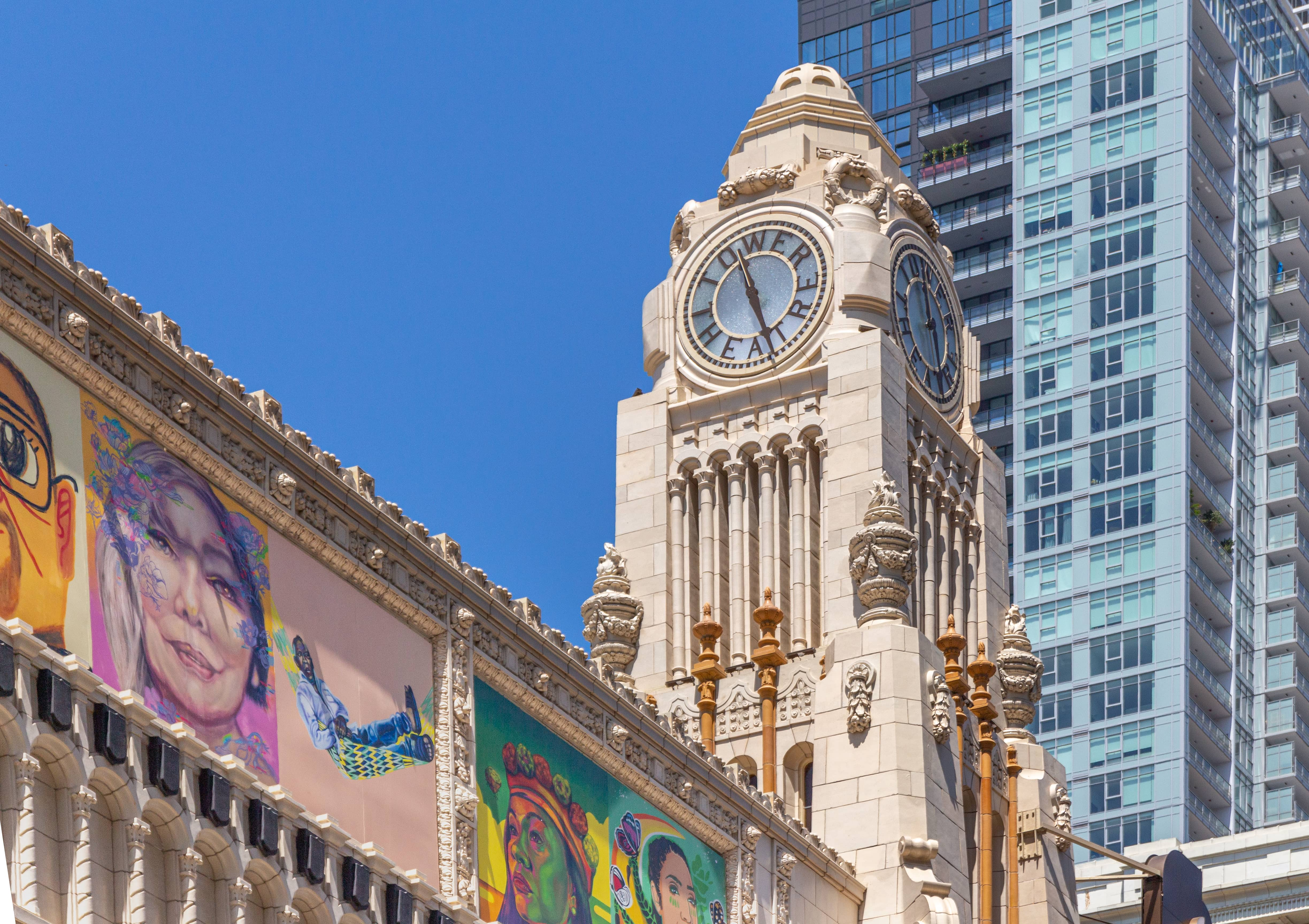Clock tower and murals at Apple Tower Theatre.