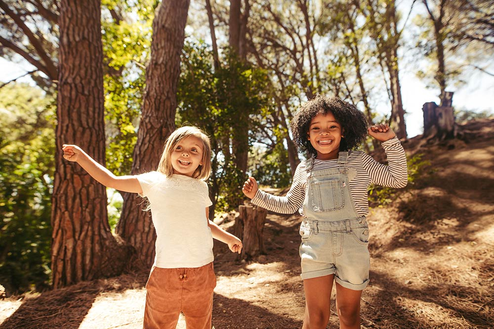 Cute kids dancing in park