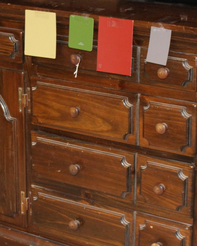 Red was the winner! As you can see it really made a big impact on the transformation of this old dresser!