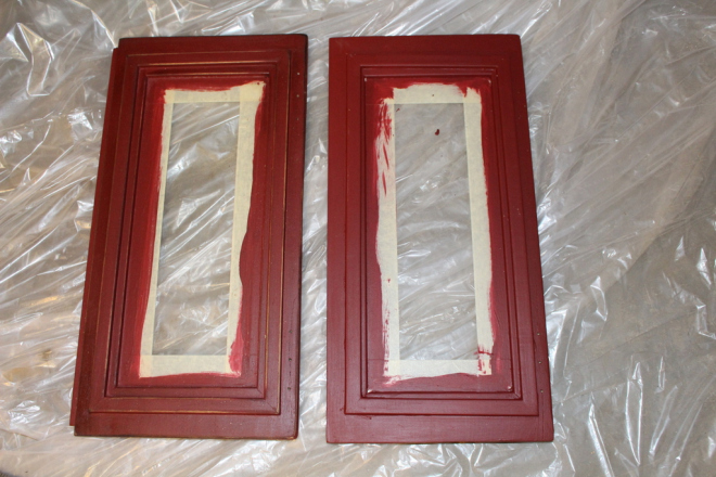 In this picture you can see the difference between the two doors: the right one is just painted the other is antiqued. Ignore the masking tape on the glass.