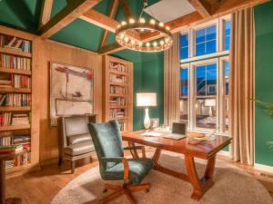 Rustic, green study.  Care of HGTV