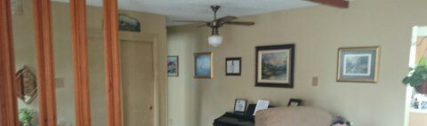 Picture Wall Before.  All the art is lined up along the hallway.