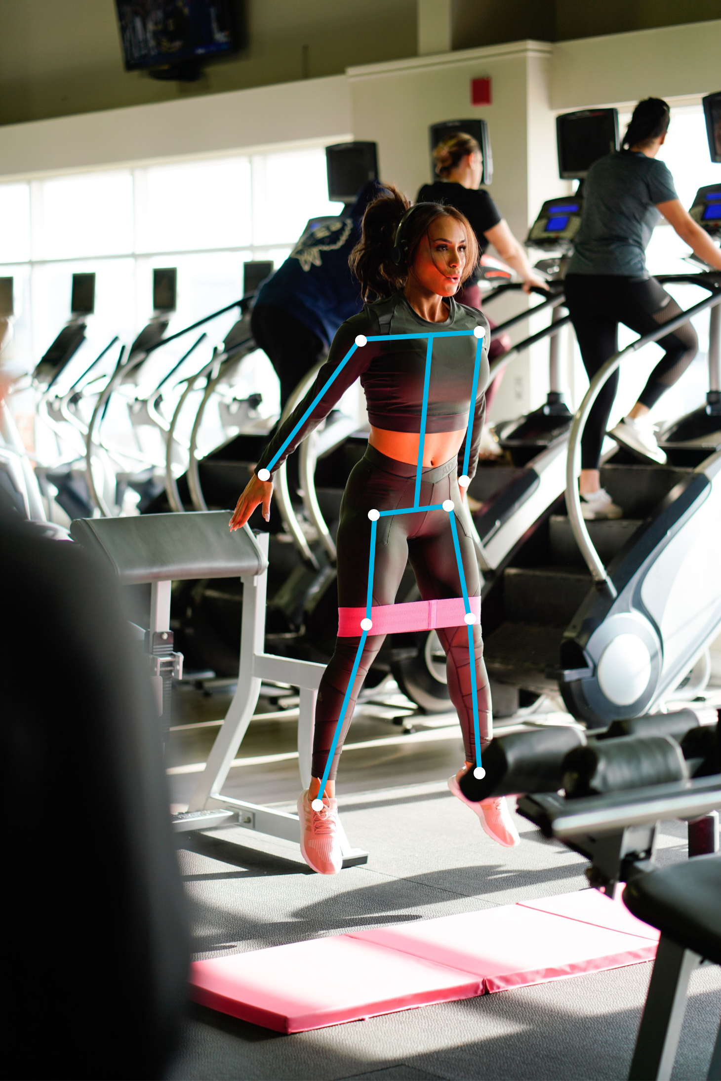 a woman working out with pose estimation on her.