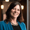 Linda Kricher from Net Health | HR customer reviewing employee experience management software