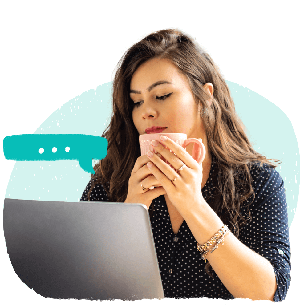 A woman with a cup looking at her laptop to see Cooleaf's pulse survey data.