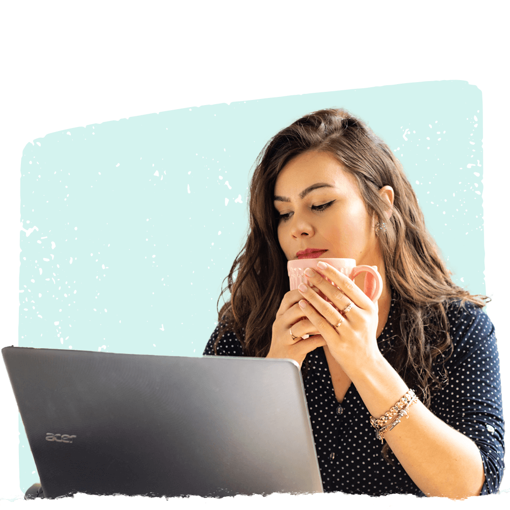 Woman with a cup using Cooleaf's employee performance management software