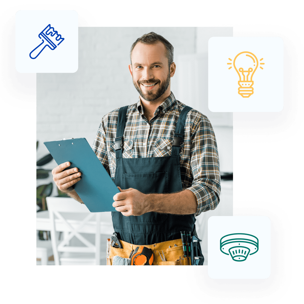 Smiling plumber holding clipboard and looking at camera in kitchen.