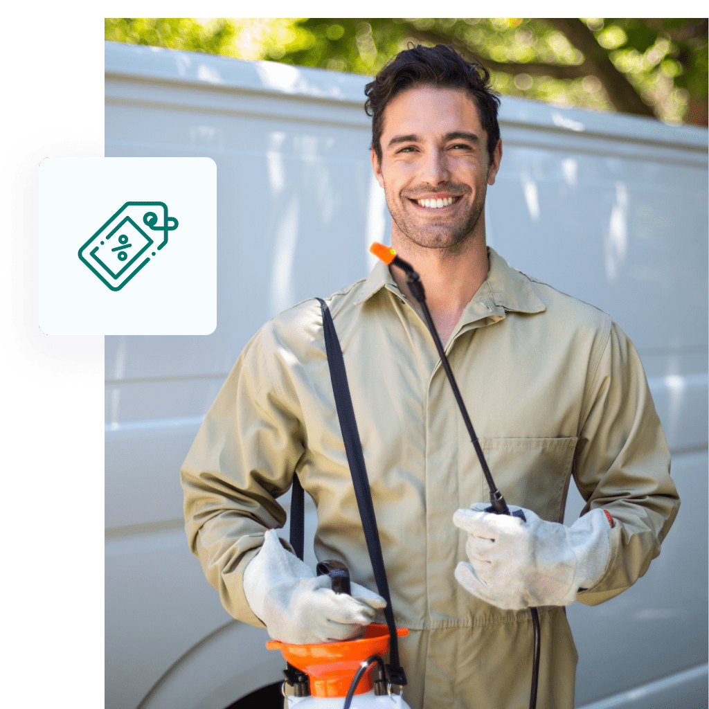 A pest control techinician standing and smiling, ready for work.