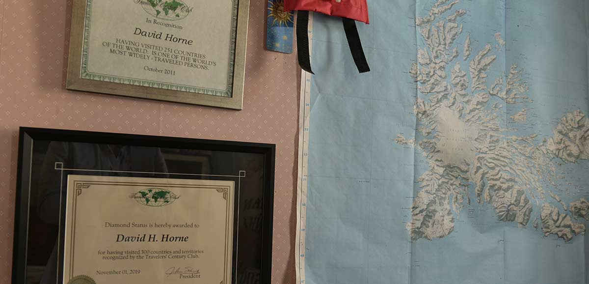 Wall hangings depicting David Horne and his travels