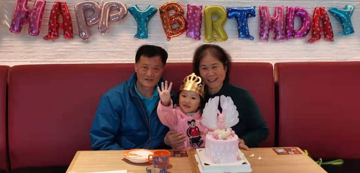Grace, Viva's daughter, aged 4, with her grandparents in China. Grace's mother Viva works for English Language Partners.