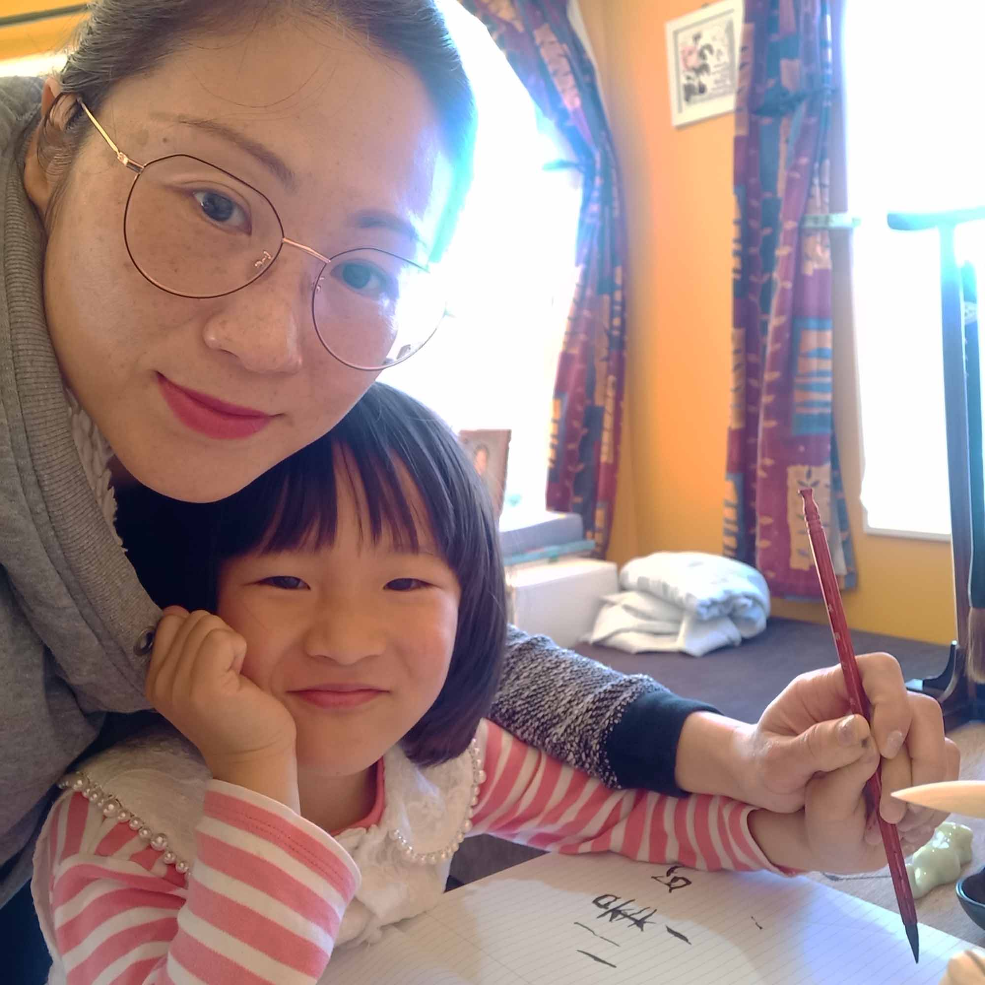 Viva, from ELP, teaching her daughter Grace to write Chinese