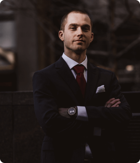 man wearing a suit crossing his hands