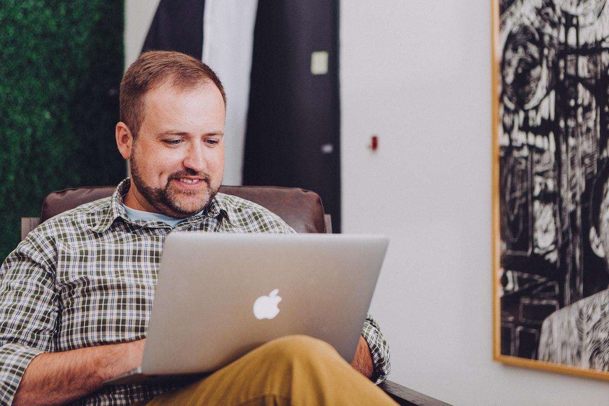 A guy using a macbook