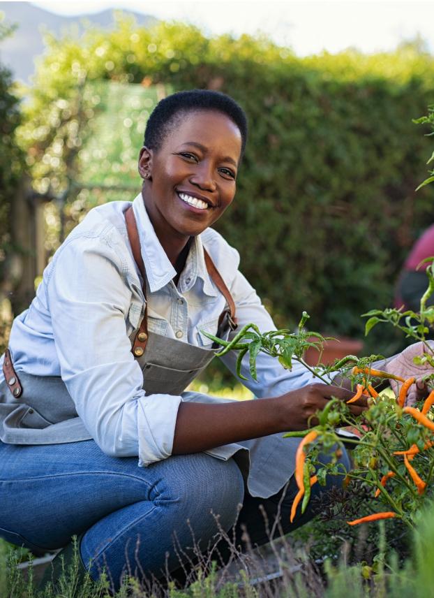 A black woman gardening