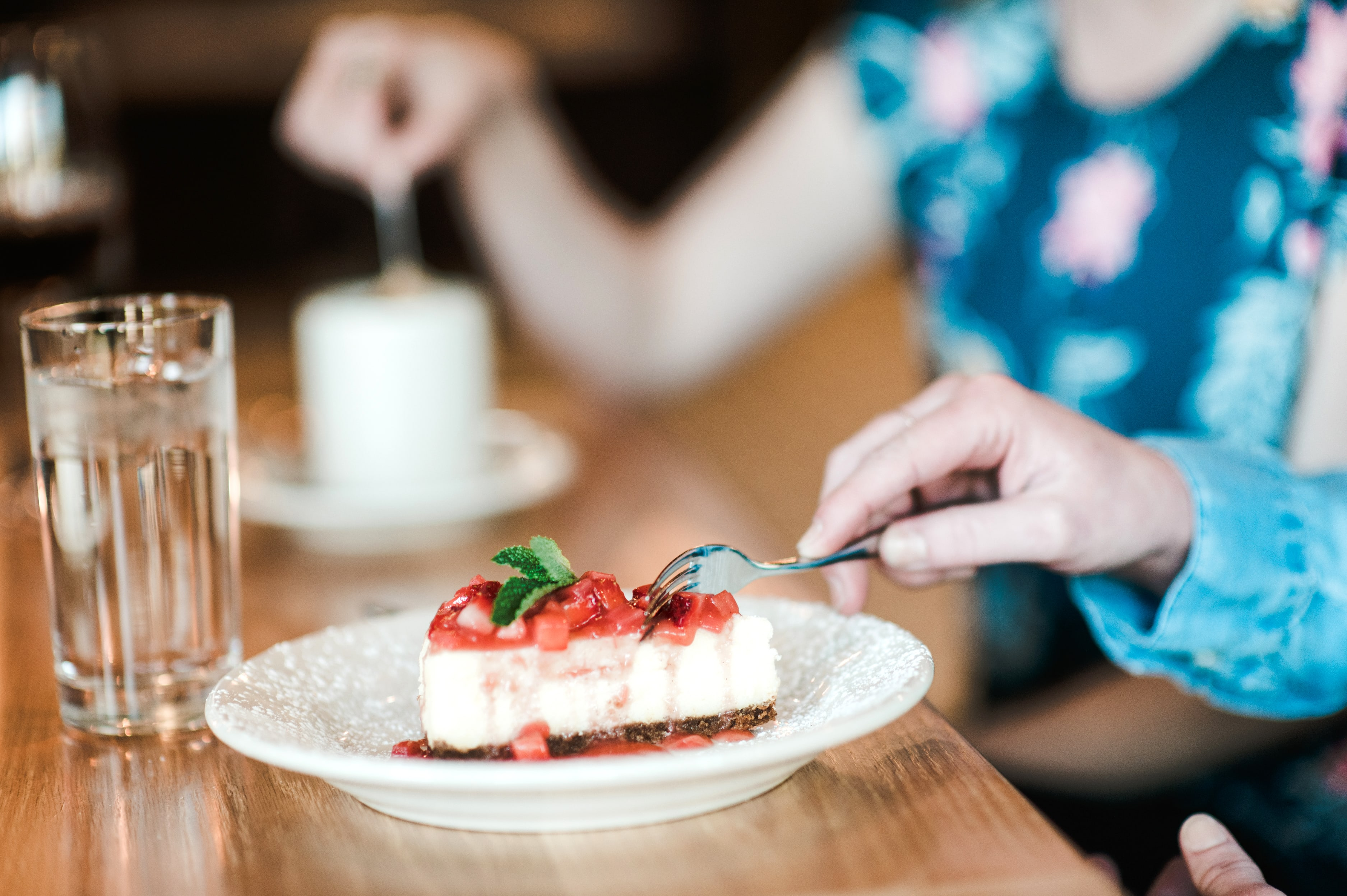 Couple eating piece of cake