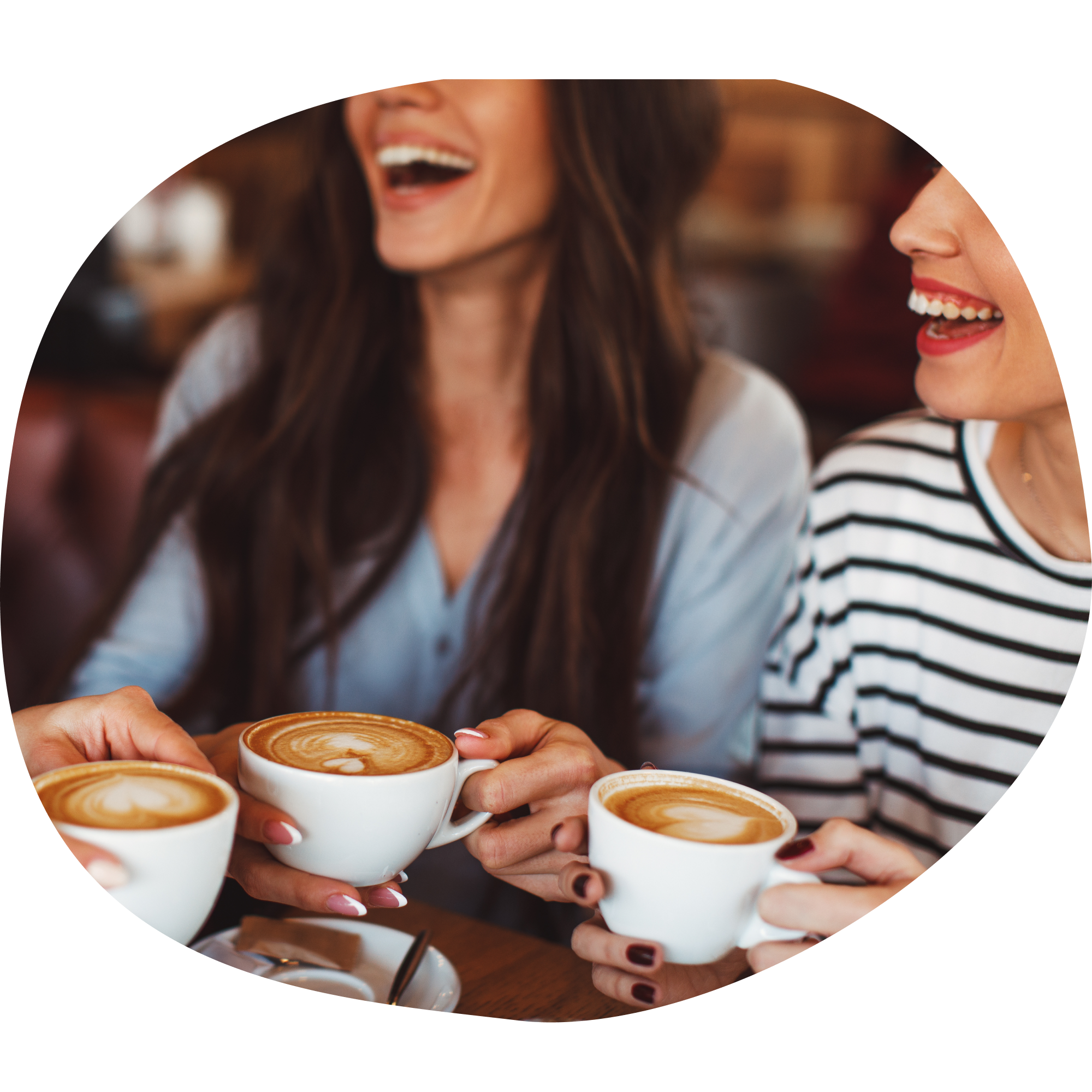 Friends at coffee shop laughing together