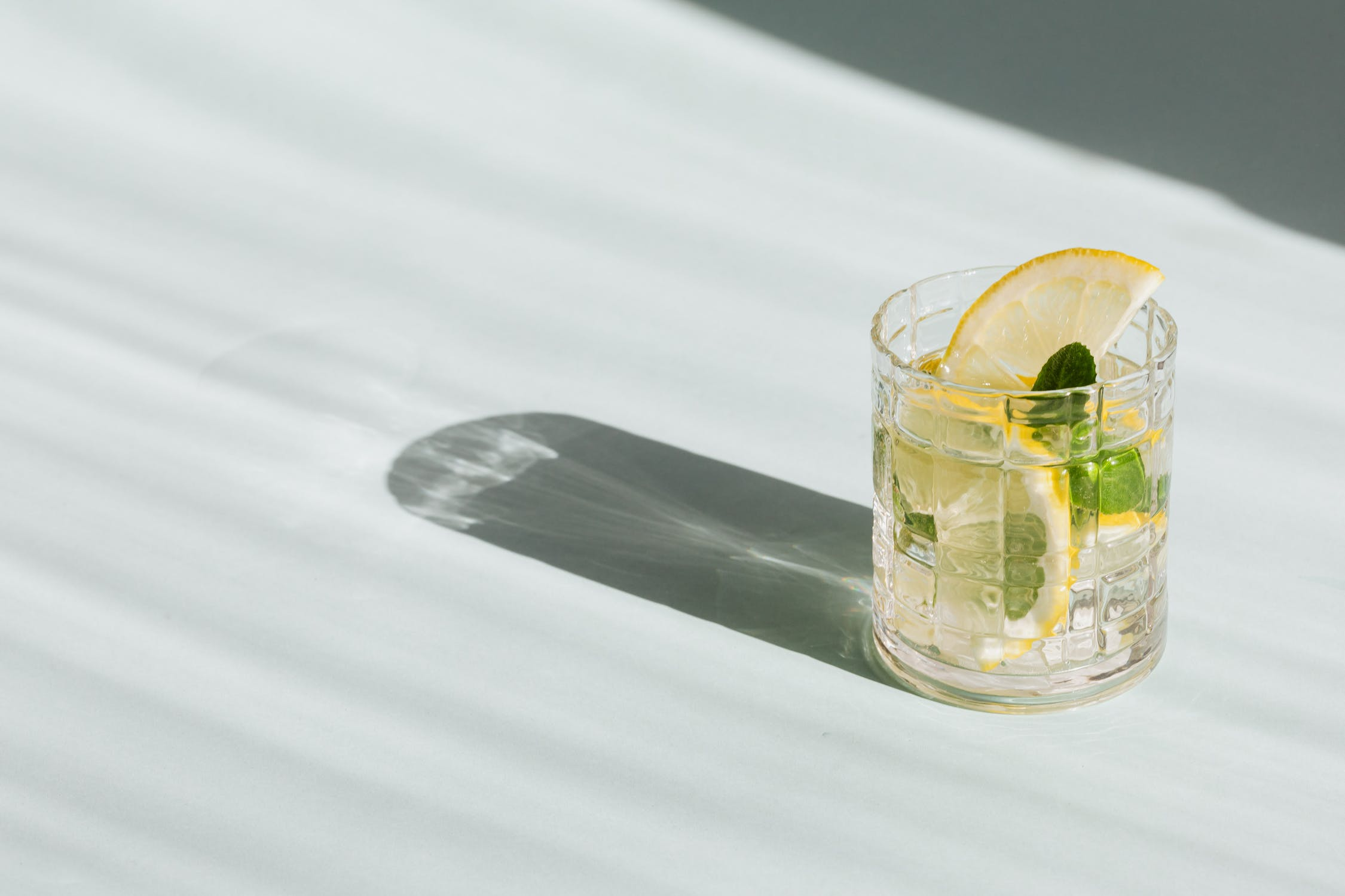 A glass of vodka and lemon