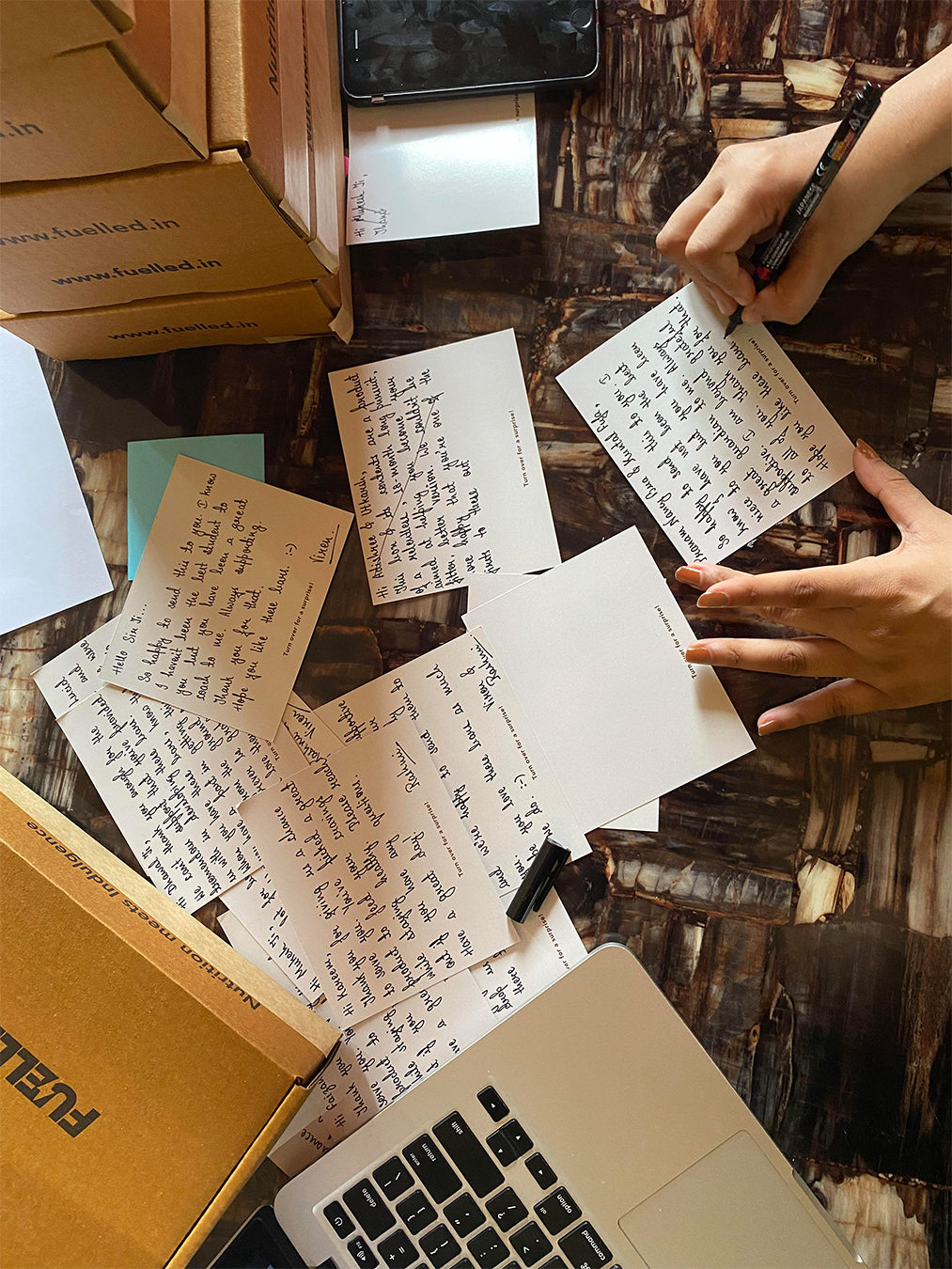Rashmi-Signing-Hand-Written-Notes-For-Fuelled-Customers