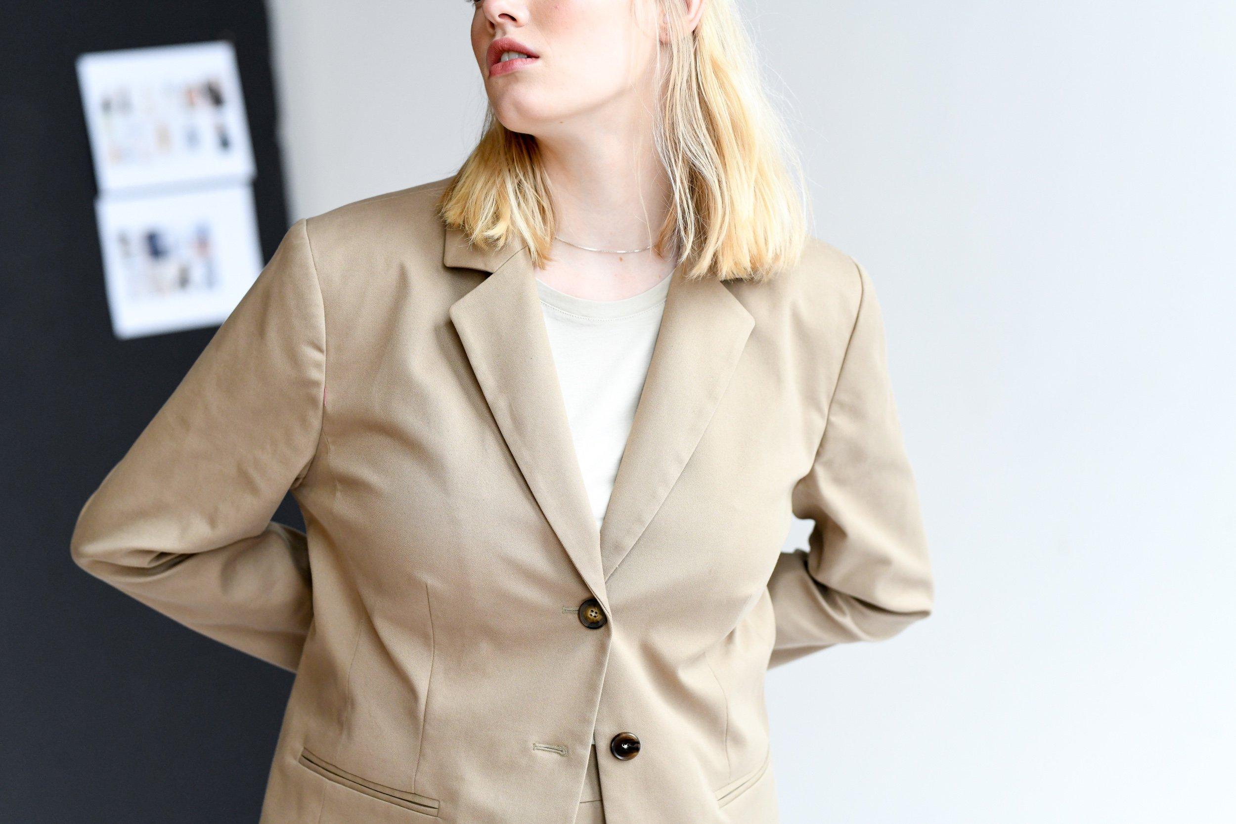 Blonde model wearing a beige trenchcoat