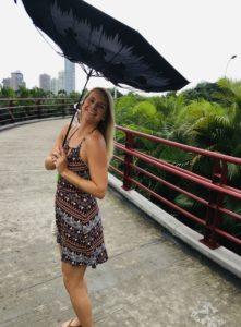 Sarah Collins with an umbrella