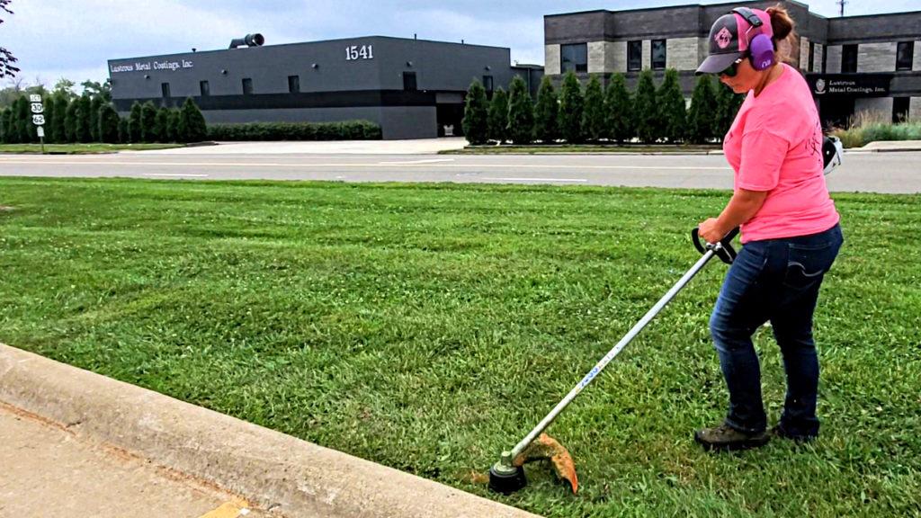 Savanaha Spencer cutting grass
