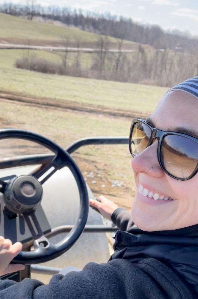Alicia Brentzel driving a golf cart