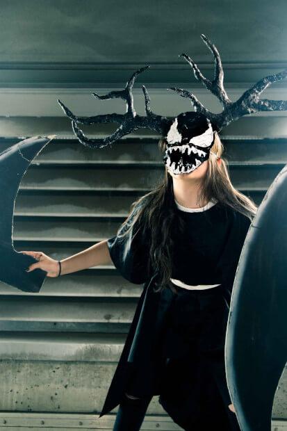 A person wearing a Venom Mask