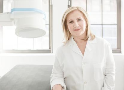 Dr. Elena Ocher standing in her office