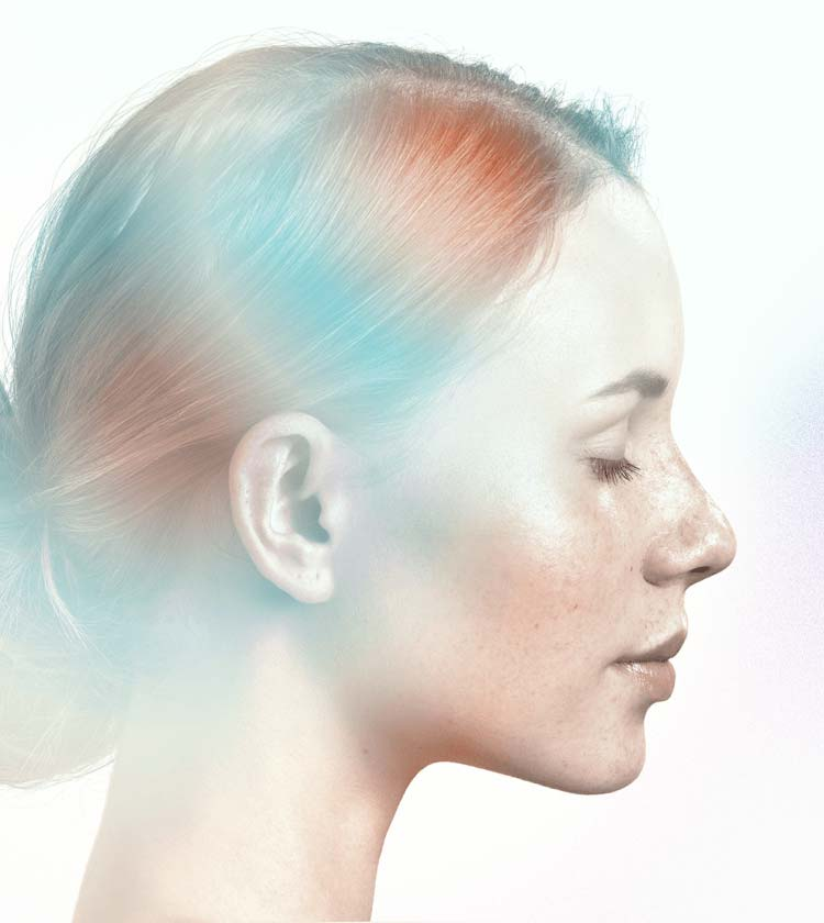 A woman's face profile with an ethereal glow and calm expression