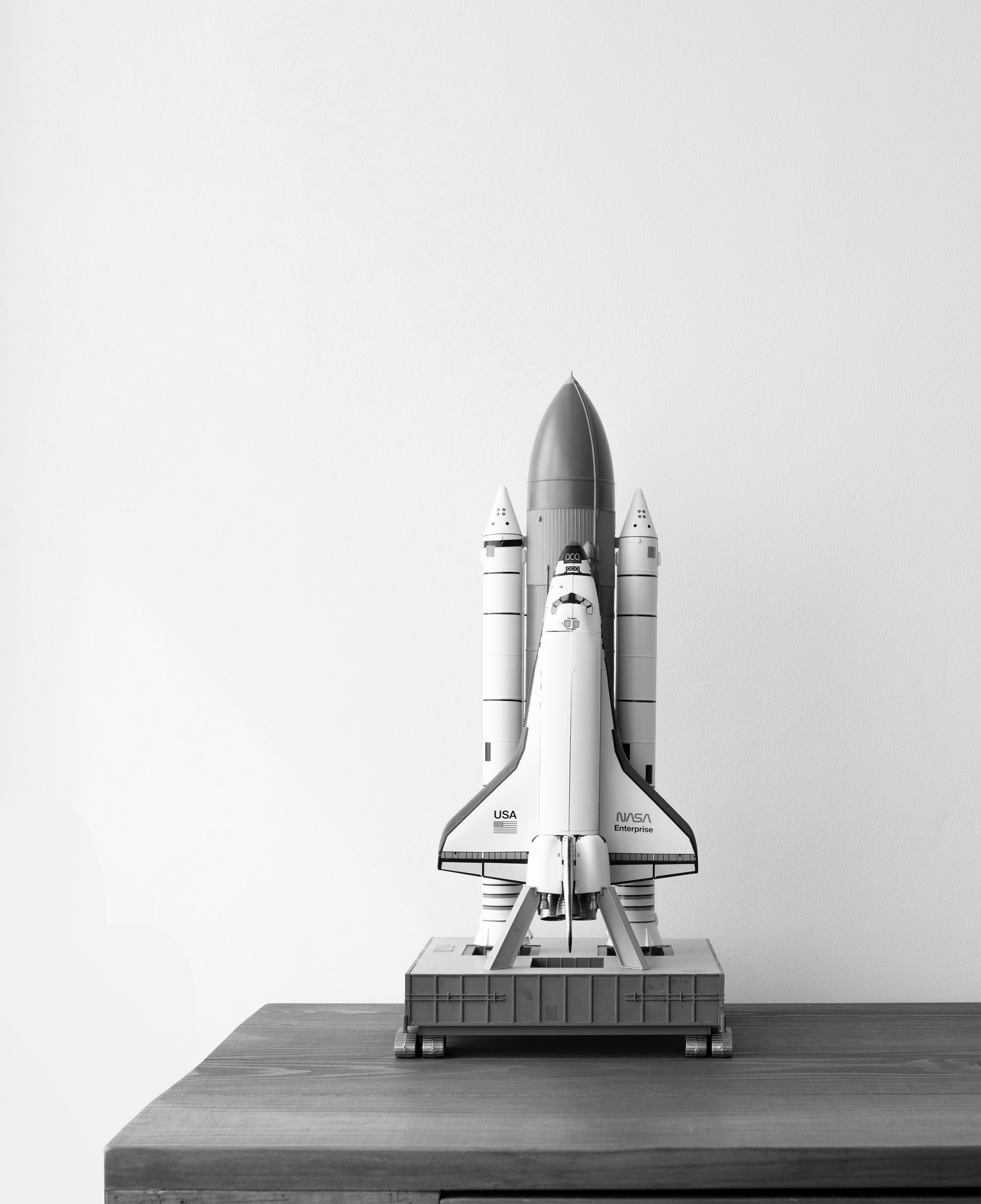 A toy space shuttle on a desk.
