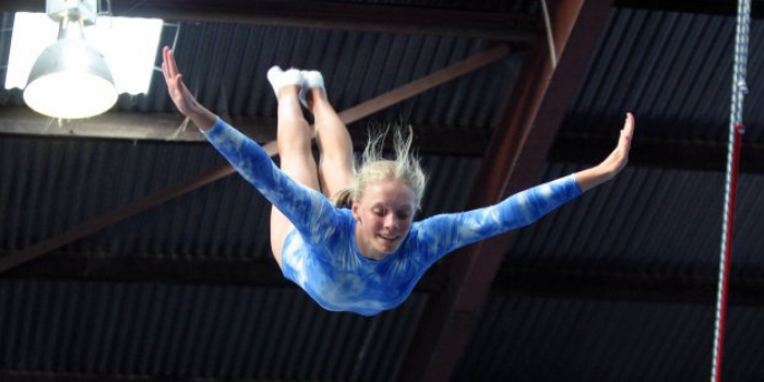 Christie Jenkins competing in a trampolining competition.