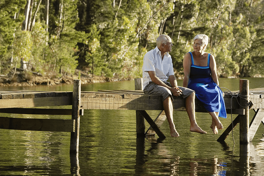 old couple sitting on dock
