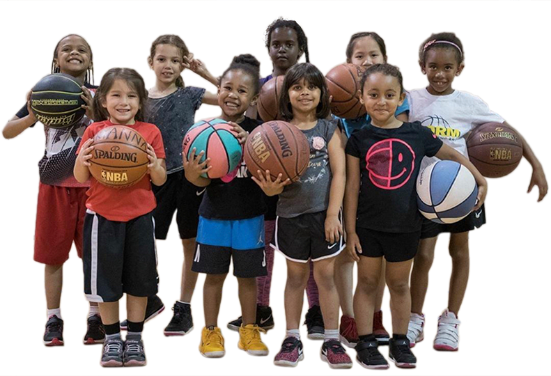 A group of cute, diverse grade-school-aged girls holding basketballs.