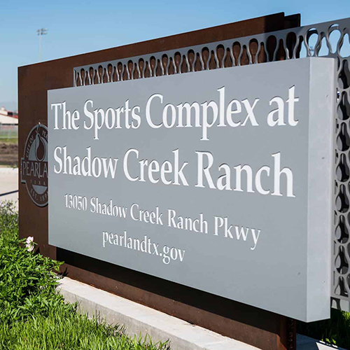 Picture of the sign for the sports complex at shadow creek ranch.