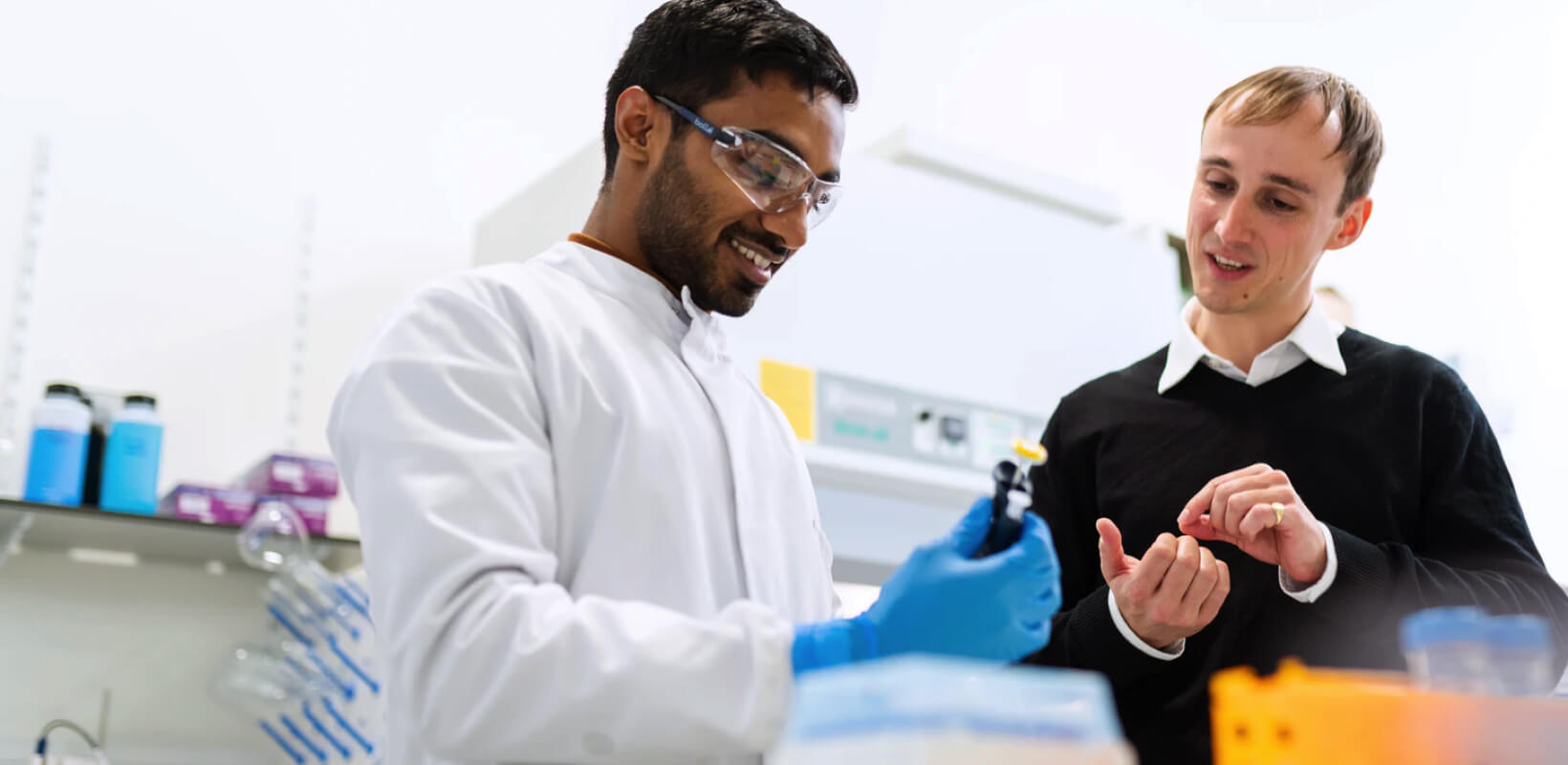 2 scientist guys trying equipments.