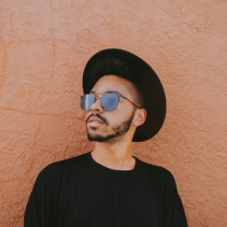 A guy in a hat with sunglasses