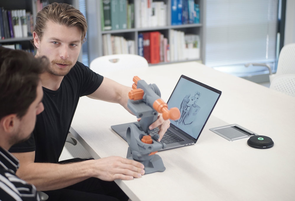 showing off a 3d printed industrial design to eachother