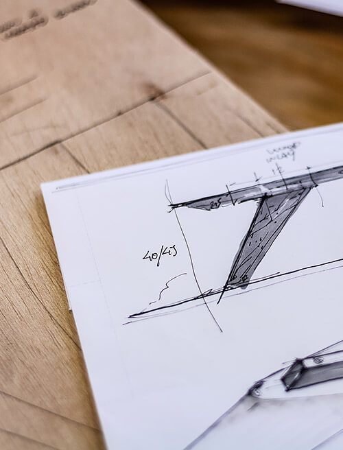 A paper on a desk with drawings of fixtures.