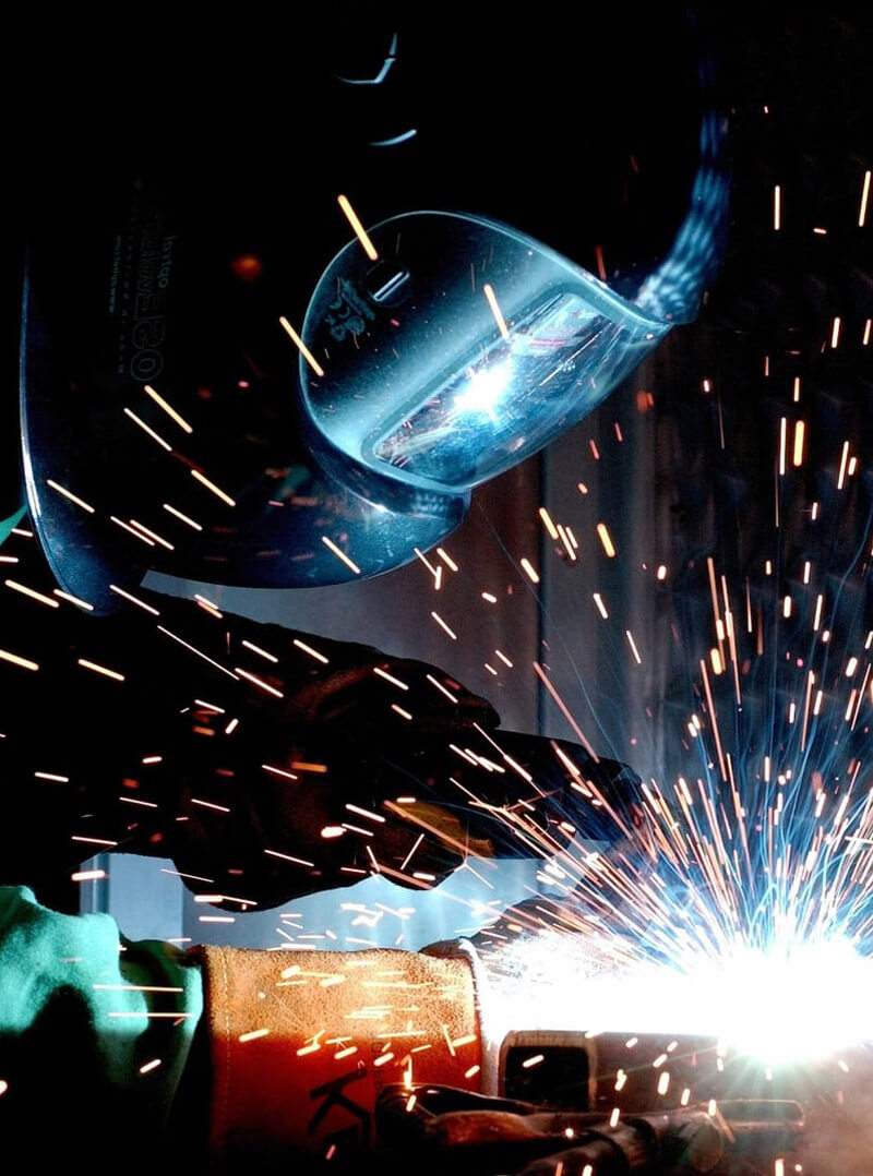 A photo of a person welding.