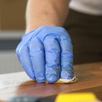 Hand polishing wood table