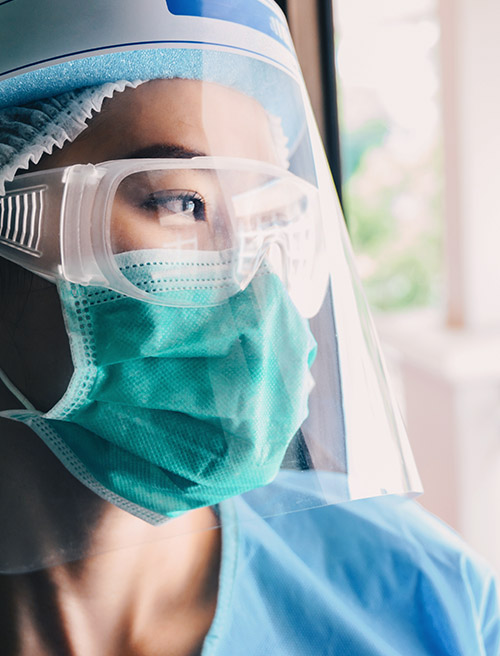 A photo of a nurse wearing PPE