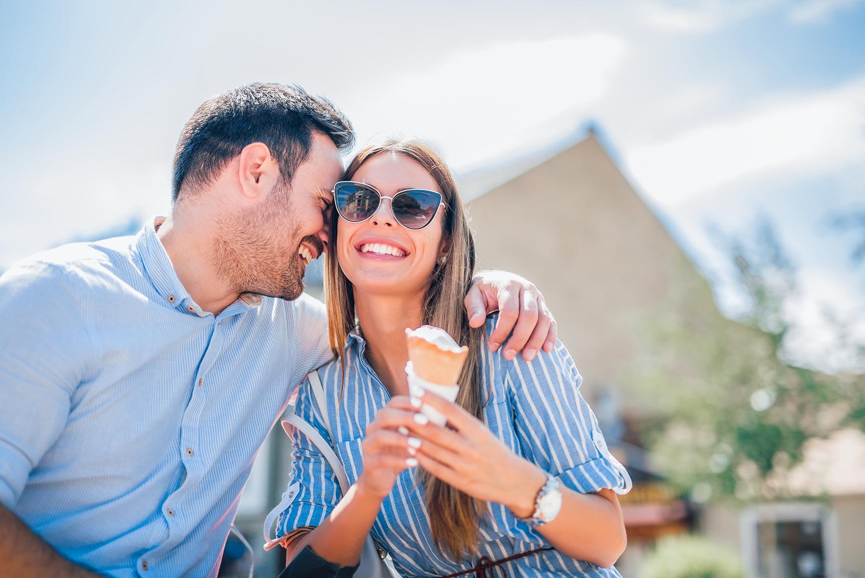 happy couple eating icecream