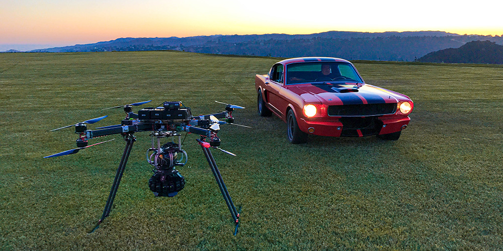 DragonFly UAS drone in flight, capturing footage of a Ford Mustang