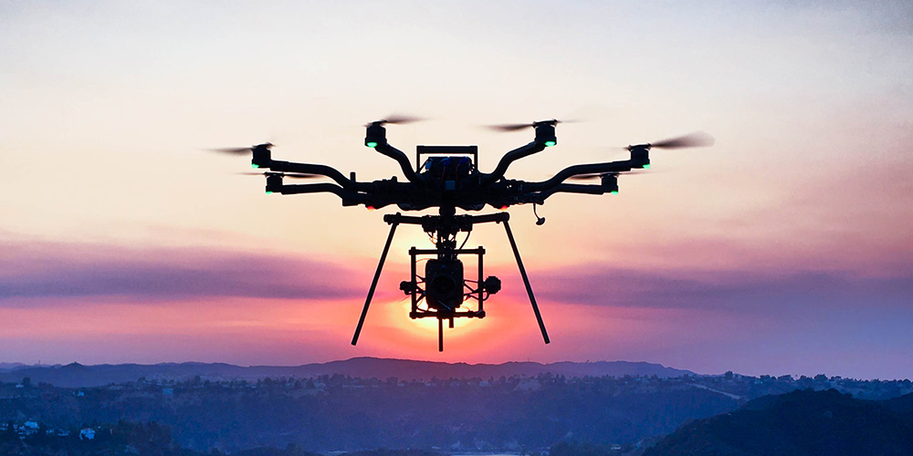Drone in flight during a sunset